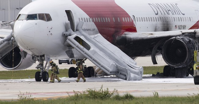 The Latest on plane fire: Flight to head to Venezuela