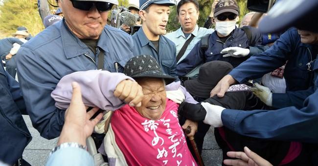 Japan overrides protests, resumes work on US base transfer