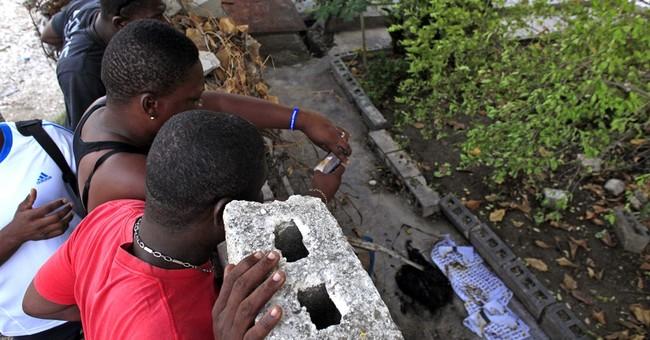 In Haiti, tire barricades burn as candidate alleges fraud