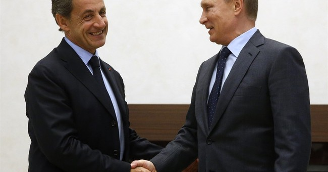 France's Sarkozy meets Putin, says West too tough on Russia