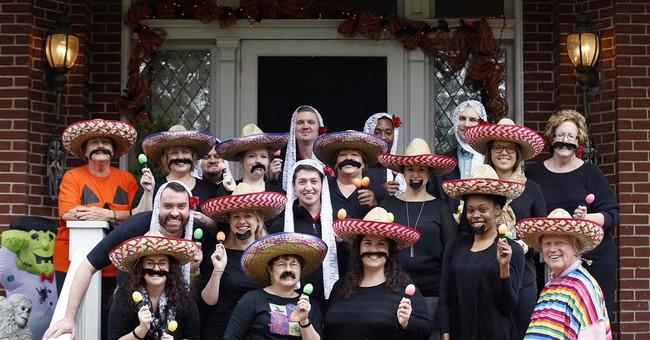University president posed for photo in sombrero, poncho