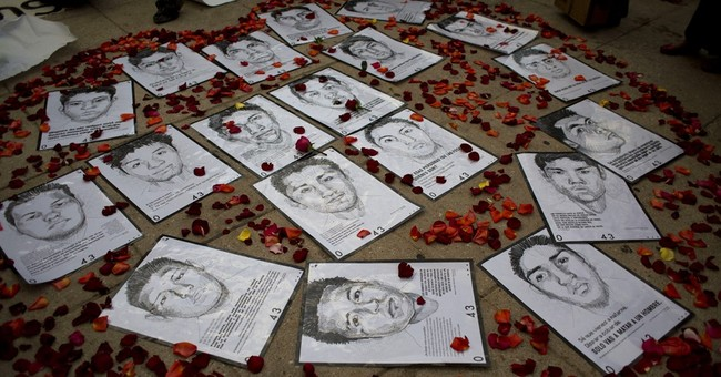 Mexican parents refuse to accept sons' deaths on Day of Dead