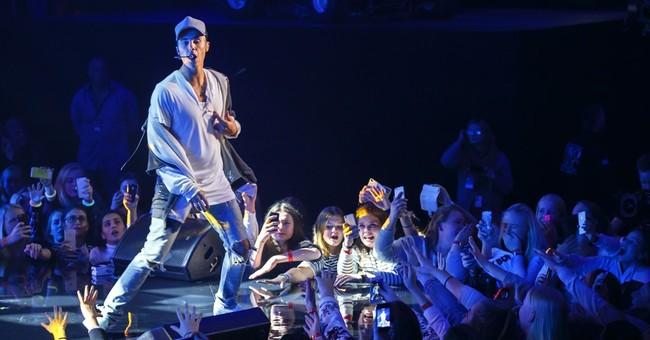 Bieber quits concert because fans won't listen to him