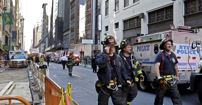 Building under demolition partially collapses in NYC; 1 dead
