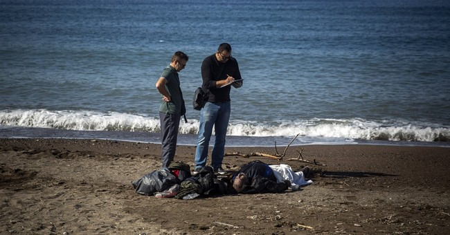 The Latest: Group: 77 kids drown at sea since Syrian boy
