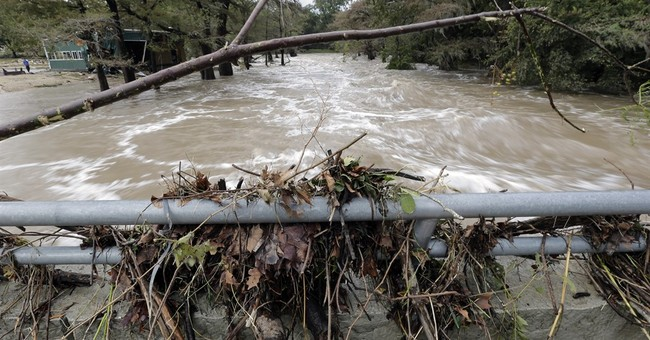 The Latest on Texas storms: Soggy Halloween in flooded Texas