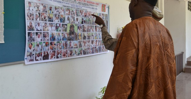 Nigeria issues poster of 100 wanted Boko Haram militants