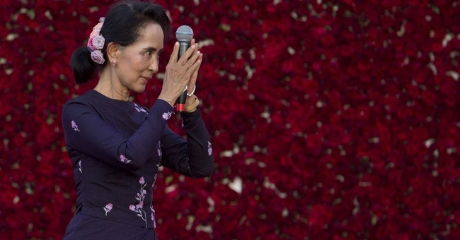 Tens of thousands in Myanmar turn out for Suu Kyi rally