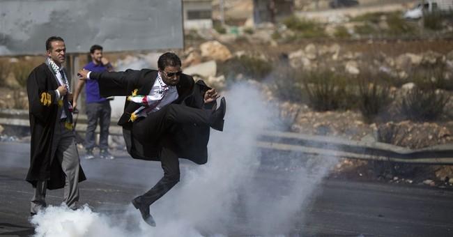 Palestinian lawyer talks about viral photo of tear gas kick
