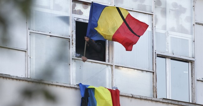 The Latest: 2 Romania nightclub victims awarded for bravery