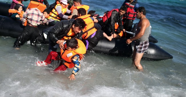 The Latest: Cyprus crews rescue 26 people from boat