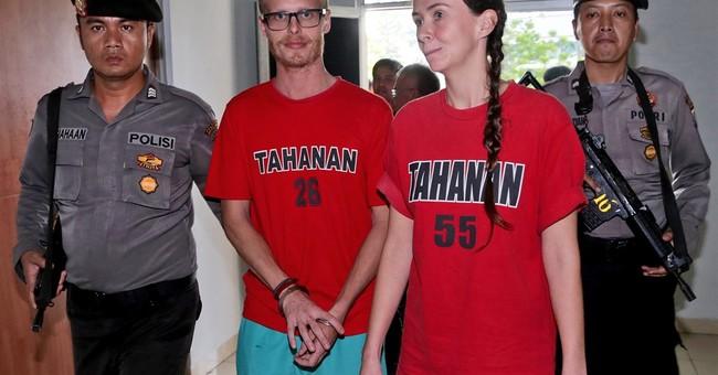 Indonesia convicts 2 British journalists for visa violations