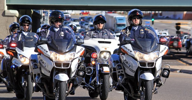 Albuquerque lays slain officer to rest in emotional service