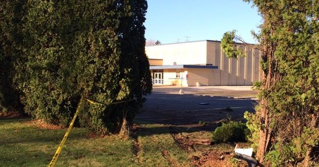 2 dead in SUV after overnight crash at Michigan school