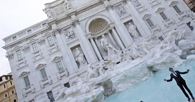 Water flows once again at Rome's restored Trevi fountain