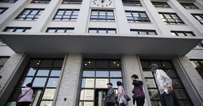 Japan Post companies net $12B in biggest IPO, shares soar