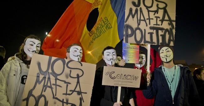 The Latest: Thousands protest in Romania for 2nd night