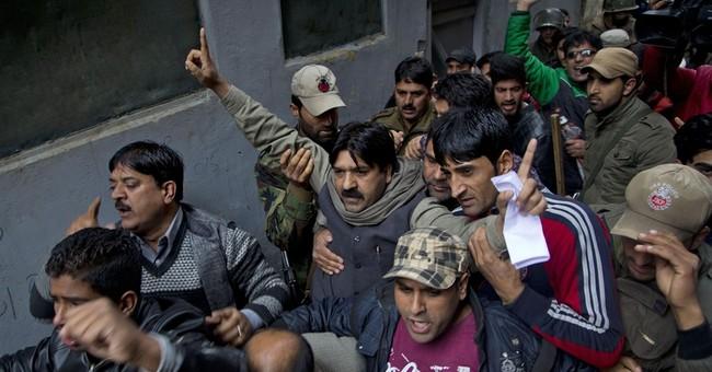 Indian police detain hundreds before Modi visits Kashmir