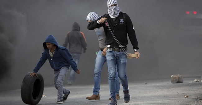Palestinian rams car into Israeli officer, then is shot dead