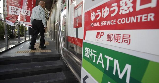 Japan Post companies net $12B in biggest IPO, shares soar