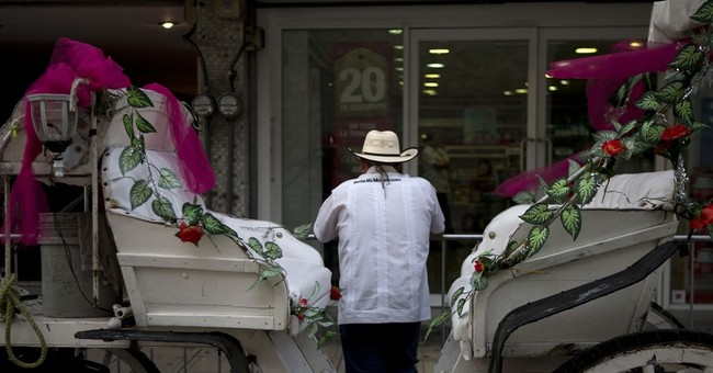 Mexico seeks to boost economic ties with Raul Castro visit