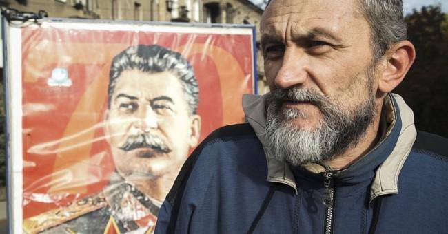 Ukraine's rebel center in limbo as fighting dies down