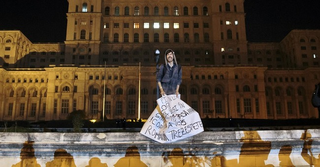 The Latest: Thousands protest in Romania for 3rd day running