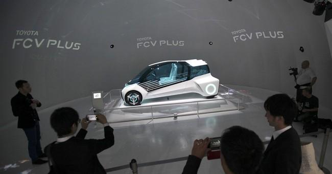 Toyota quarterly profit rises to $5 billion on weak yen