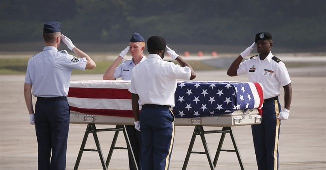 Carter checks on lab effort to ID airman lost in Asia