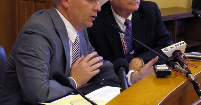 Kansas slashes revenue forecast, adjusts budget to avert gap
