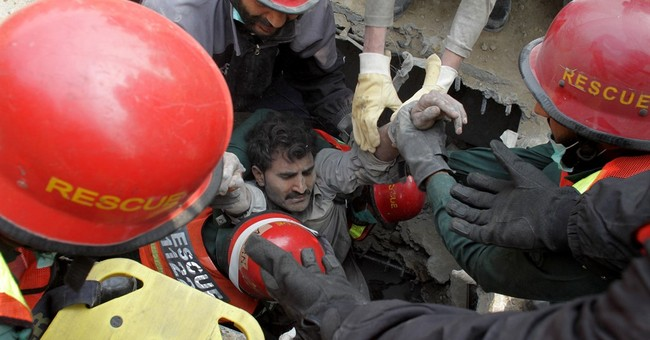 Pakistani rescuers save man 50 hours after building collapse