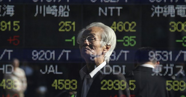 Stocks end mixed as market factors interest rate hike