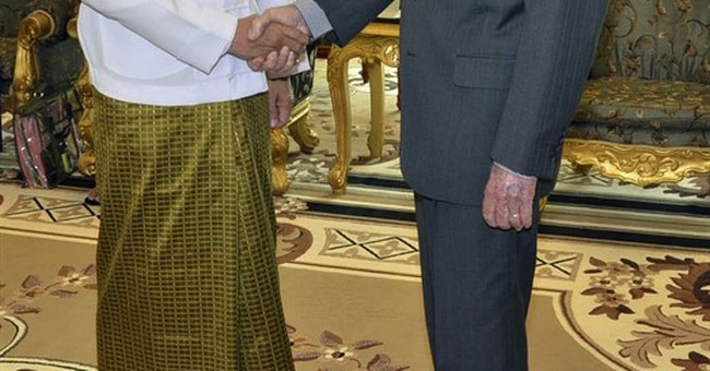 Carter watches from afar as his center monitors Myanmar vote