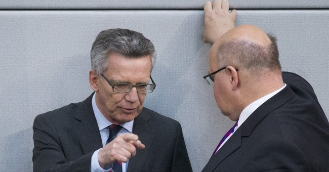 German coalition sends conflicting signals on Syrian asylum