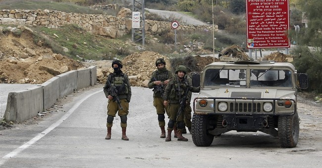 Police: Palestinian rams car into Israelis in West Bank
