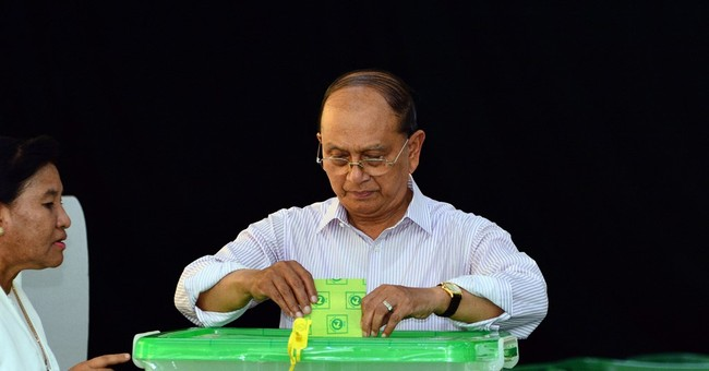 Myanmar president votes in 'military country'