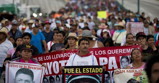 Mexico rights group blasts prosecutors over missing students