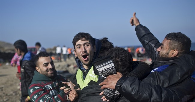 The Latest: Spain gets 1st batch of Syria, Eritrea refugees
