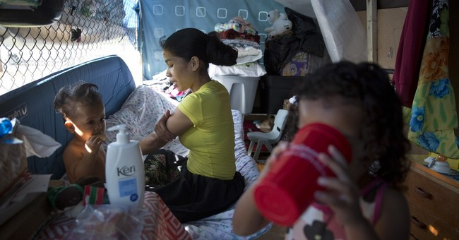 AP PHOTOS: Homeless struggle with high costs of Hawaii