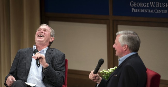 George W. Bush speaks with father's biographer