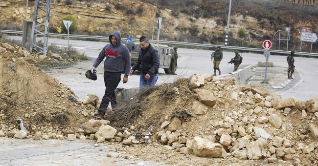 Police: Palestinian rams car into Israelis in West Bank