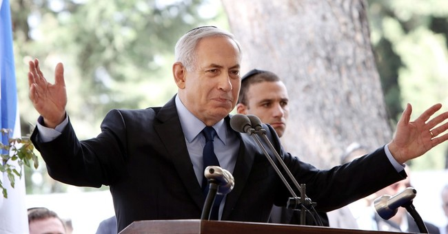 Israeli leader heads to Washington as spokesman draws fire