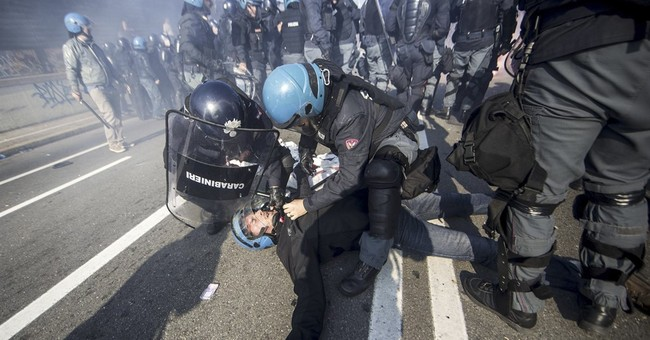 Protesters clash with police in Bologna