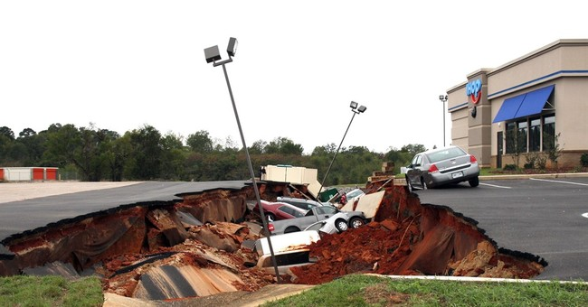 Engineers examining collapsed parking lot in Mississippi