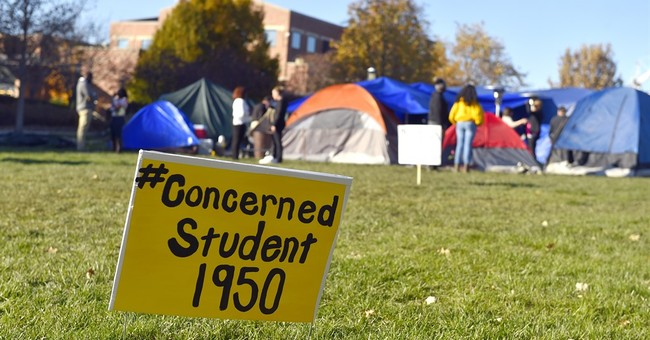 Latest on Missouri turmoil: Protesters pray, set to camp out