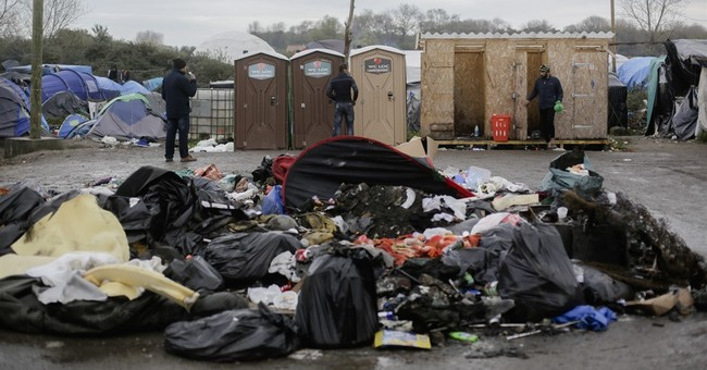 27 police hurt in 2 nights of unrest at Calais migrant camp