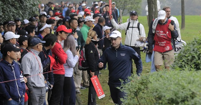 Knox goes from cart boy to World Golf Championship winner