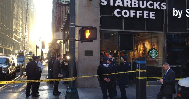 Police: 3 shot, 1 dead, in midtown Manhattan subway entrance