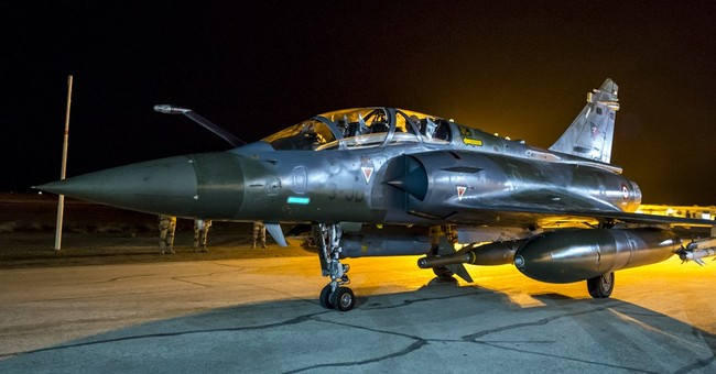 France's airstrike targets an oil center in Syria