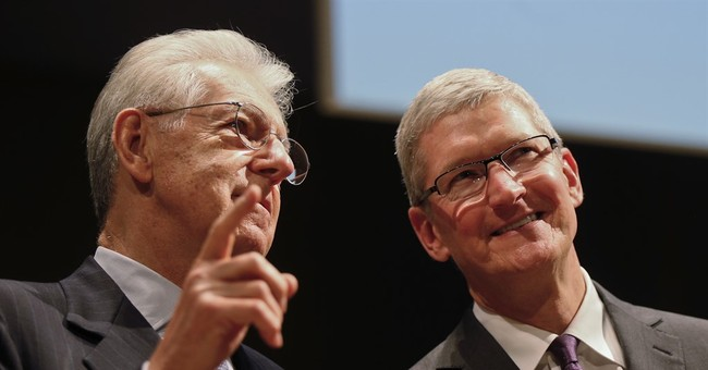 Apple boss pushes business to help solve social problems